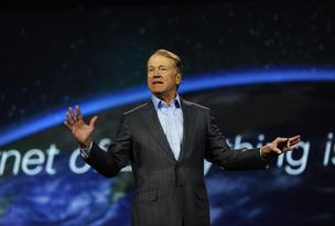 John Chambers, chairman and chief executive officer of Cisco Systems Inc., delivers a keynote speech during a news conference at the 2014 Consumer Electronics Show (CES) in Las Vegas, Nevada, U.S., on Tuesday, January 7, 2014. Cisco is making several announcements, including a deal with Samsung Electronics Co. yesterday to offer Web conferencing capabilities on Galaxy devices, as well as a new cloud-based video service that lets service providers and media companies deliver video to consumers faster.
