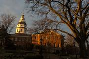 The sun rises over the Maryland State House on the opening day of the 2014 legislative session in Annapolis.