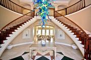 The entryway, bedecked with a colorful chandelier, to the oceanfront home on Ponte Vedra Boulevard listed for sale at $7.9 million.