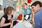 Nick Dougherty meets with a young patient and nurse Samantha Heim at the Franciscan Hospital for Children in Brighton to try a new system for patient engagement made by his startup Verbal Applications.