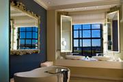 The W Washington, D.C.: Extreme WOW Suite The damage: $10,000 a night The living room is clad with Wengé herringbone wood floors, black-and-white Murano glass chandelier and a virtual fireplace.