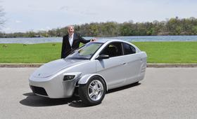 Paul Elio with his car, the Elio Price: $6,800 MPG: 84 Horsepower: 55 Engine: 3-cylinder, 9-liter Wheels: 3 Transmission: 5-speed manual and automatic HQ: Phoenix Manufacturing: Shreveport, La. Development: Detroit