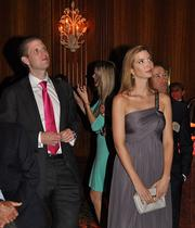 Eric and Ivanka Trump listen to their father.
