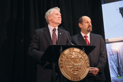 Gov. John Kitzhaber and acting Cover Oregon Executive Director Bruce Goldberg at a press conference to discuss health enrollment numbers on Jan. 9.