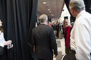 The curtain is opened for Bobby Petrino as he makes his way out to a crowd of fans waiting to see their new coach.