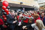 Bobby Petrino signing autographs for fans after being named the new head football coach.