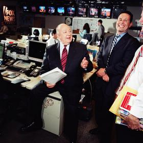 Roger Ailes, president of Fox News with Brian Kilmeade, Fox News Host, in the Fox News Channel newsroom in 2005.
