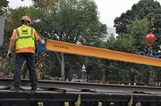 Streetcar track construction in Cincinnati restarted after a $9 million pledge to fund operations.