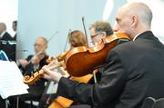 Members of the Kansas City Symphony play during a reception for the late R. Crosby Kemper Jr. Kemper played a vital role in saving the symphony from financial troubles.