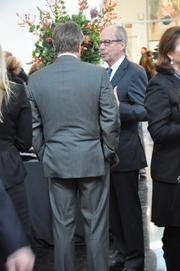 Attendees talk during the reception for the late R. Crosby Kemper Jr.