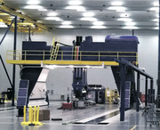 A house-sized carbon-fiber tape-laying machine made by Mukilteo-based Electroimpact Inc. is similar to ones the company hopes to sell to Boeing to build the 777X wings.