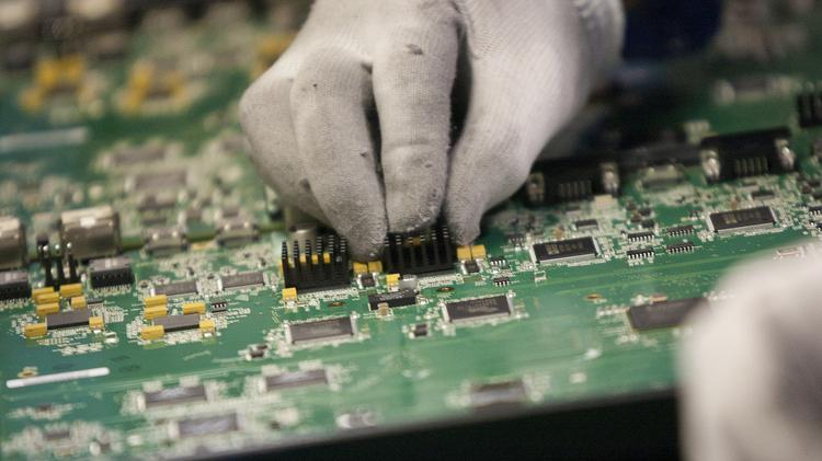 VICKI THOMPSON (07/17/12) Employees at SMTC work on circuit boards on the companies San Jose Manufacturing floor.