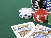 King and queen cards with poker chips