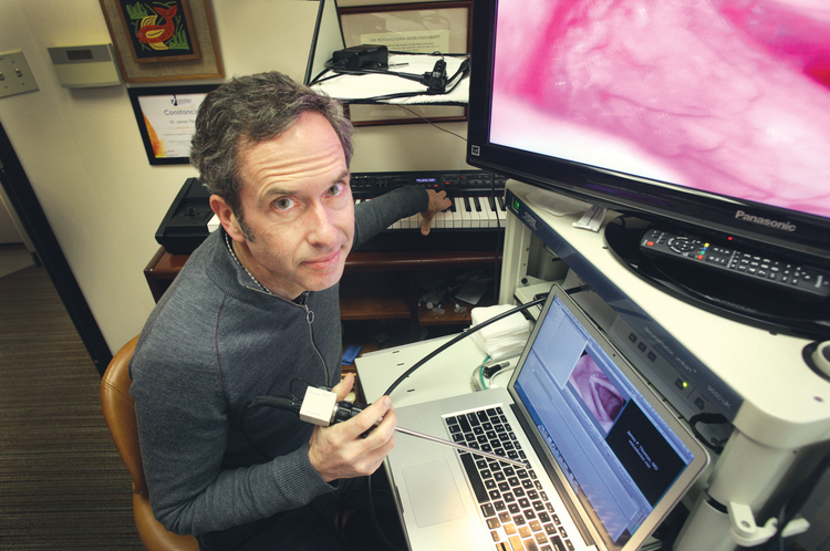 "Vocal specialist Dr. James Thomas relies on his ears, rather than his eyes, to detect throat disorders. ""I hear the story, listen to the voice and hear the problem."""