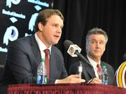 Jay Gruden, left, speaks to the media after he was named to Redskins coach in January.