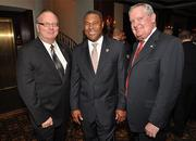 William Bentson of Cadillac, Nat Moore, former Miami Dolphin # 89 and G. Ed Williamson II of Williamson Automotive Group.
