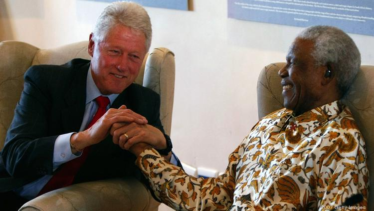 Former President Bill Clinton embraces former South African President Nelson Mandela following remarks by Clinton during a visit to the Nelson Mandela Foundation July 19, 2007  in Johannesburg, South Africa.