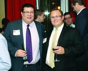 T.J. Drost, left, and Ryan Neupaver of Select Financial Group, LLC.