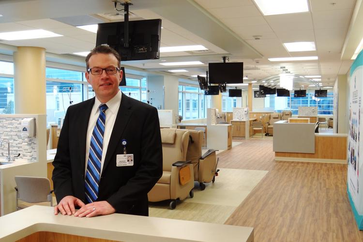 Brendan Fitzpatrick, director of the Cone Health Cancer Center at Alamance Regional, stands in the new $21 million center's infusion area where patients will receive chemotherapy treatment.