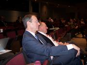Robert Miller (left), CEO of Windsor Development Group Inc. in Clifton Park ,and Bob Blackman, vice president of RealtyUSA and chairman of Albany's Center for Economic Growth, listen as panelists at the nanotech symposium talk about New York's growing nanotechnology cluster.