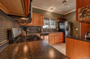 3626 Cambridge Ave.: The kitchen cabinetry and ceramic tile flooring are new.