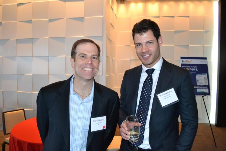 Fred Kleiman, left, of PCI, and Daniel Cohen, of Shift Systems, were among about 80 guests Thursday at the BizMixer at the Sunset Room by Wolfgang Puck at National Harbor.