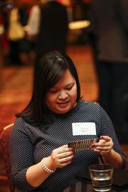 Tiff Pua of MPTV checks out the Milwaukee Wave vouchers donated to the event by Wave owner Sue Black.