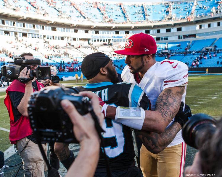 Carolina Panthers wide receiver Steve Smith congratulates San Francisco quarterback Colin Kaepernick. The 49ers beat the Panthers 23-10 in the divisional playoff game on Jan. 12, 2014, at Bank of America Stadium in Charlotte.