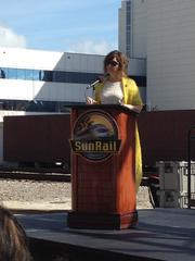 "FDOT District 5 Secretary Noranne Downs was sporting her signature SunRail yellow as she celebrated that ""we've been working on the railroad."""