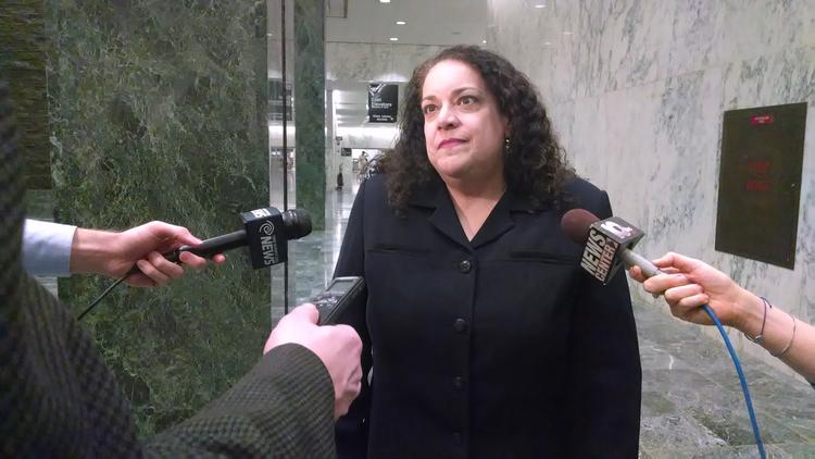 Donna Frescatore, executive director of New York's health insurance exchange, answers questions after testifying before the state Senate on Jan. 13.