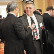 Lawyer Ted Lee of Gunn, Lee & Cave talks with guests. His firm was one of the sponosrs of the event.