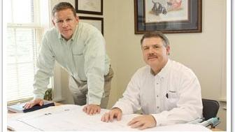 Scott Moss (from left) is president of Moss & Associates, and Don Warren is executive vice president.