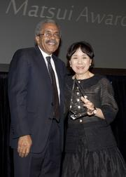 Third District Court of Appeal presiding justice Vance Raye poses with Congresswoman Doris Matsui after receiving the Robert T. Matsui Community Service Award at the annual Martin Luther King Jr. dinner.
