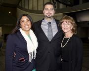 Community volunteer Sarah Greenwell, U.S. Department of Justice community outreach specialist Sean W. Vassar and e.Republic director of corporate communications Patty Cota pose at the annual Martin Luther King Jr. dinner.
