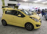 The 2014 Chevy Spark, a 5-door hatchback taht starts at $12,995 and looks like it is trying to compete with the Smartfortwo, the Scion iQ and the Fiat 500.