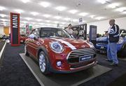 The Mini Cooper Hardtop, which debut this year. It takes a new approach to fuel economy, utilizing a three cylinder turbo engine to improve efficiency.