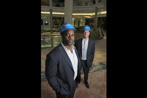 Former Cincinnati Bengals safety Chinedum Ndukwe's new real estate development and investment firm has partnered with JDL Warm Construction CEO Jake Warm (background) to redevelop Tower Place Mall.