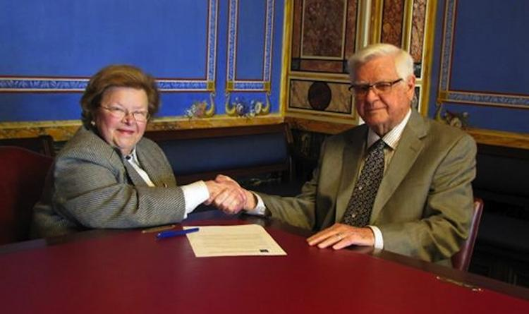 Congress' top appropriators, Sen. Barbara Mikulski, D-Md., and Rep. Hal Rogers, R-Ky., shake hands on their government spending deal.