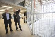 Theisen, left, and Lemoine discuss what will be done with the atrium space, which is currently gated off during ongoing construction.