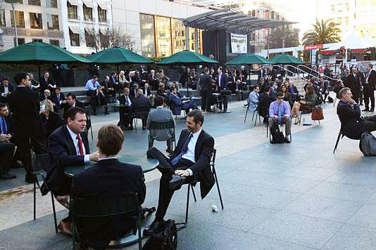 Executives soak up the sun — and deals — on San Francisco's Union Square, across the street from the Westin St. Francis hotel, home of the 32nd annual J.P. Morgan Healthcare Conference.