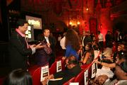 Attendees talk before the event begins at Tampa Theatre.