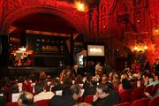 Attendees talk before the event begins at Tampa Theatre. More than 200 people attended.