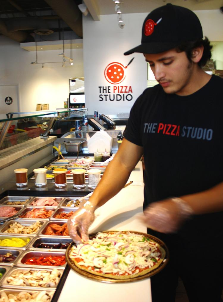 The Pizza Studio pizzas are customized and prepared in an average of seven minutes. A location will open in Mall of America next week.