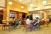 Residents watch a little television while getting some physical therapy,