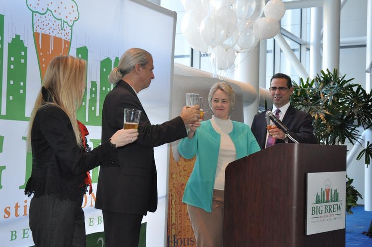 Houston Mayor Annise Parker offers a toast to Big Brew 2014, the craft beer festival coming to the George R. Brown Convention Center in October. On hand with the mayor at Tuesday's press conference were, from left, Lisa Rydman-Key of event sponsor Spec's Wine, Spirits and Finer Foods; Big Brew producer Clifton McDerby of Food & Vine Time Productions; and Luther Villagomez, general manager of the GRB and COO of conventions for Houston First Corp., the GRB's parent organization.