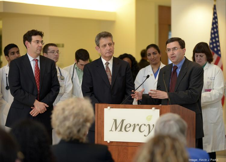 John Colmers and Dr. Joshua Sharfstein unveil the state's Maryland's new Medicare waiver at an event earlier this month.