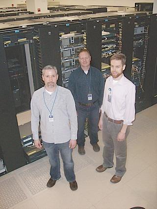 Helping to maintain supercomputers at the Center for Computational Research are, from left, Salvatore Guercio Jr. and Jon Bednasz, senior systems administrators; and Andrew Bruno, senior programmer/analyst.