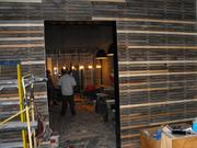 A view from Block Butcher Bar's retail area into the eating space and bar.