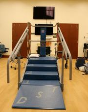 This contraption is an adjustable set of stairs, also for physical therapy
