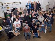 The FamiLab group gets together for a photo. A 3-D printer, Google Glass, animatronics and even chainmail are shown off.